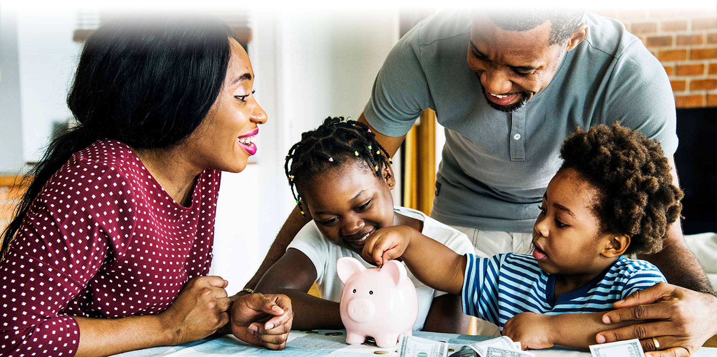 Family at dinner table with piggy bank, saving, piggy bank
